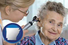 ar a otolaryngologist examining the ear of a patient