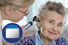 colorado a otolaryngologist examining the ear of a patient