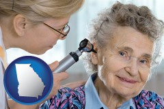 ga a otolaryngologist examining the ear of a patient