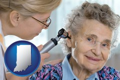 in a otolaryngologist examining the ear of a patient