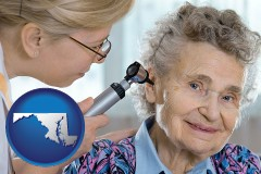 maryland a otolaryngologist examining the ear of a patient