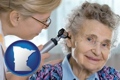 minnesota a otolaryngologist examining the ear of a patient