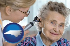 north-carolina a otolaryngologist examining the ear of a patient