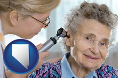 nevada a otolaryngologist examining the ear of a patient