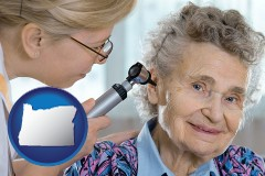 or a otolaryngologist examining the ear of a patient