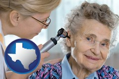 texas a otolaryngologist examining the ear of a patient