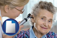 utah a otolaryngologist examining the ear of a patient