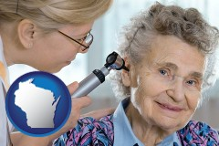 wisconsin a otolaryngologist examining the ear of a patient