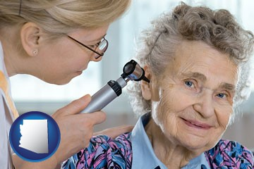 a otolaryngologist examining the ear of a patient - with Arizona icon