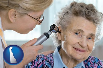 a otolaryngologist examining the ear of a patient - with Delaware icon