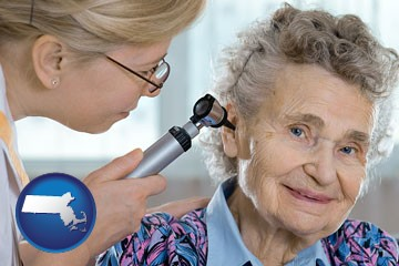 a otolaryngologist examining the ear of a patient - with Massachusetts icon