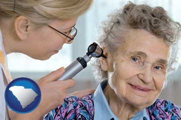 a otolaryngologist examining the ear of a patient - with South Carolina icon