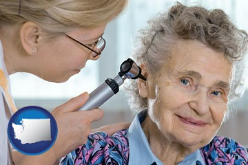 a otolaryngologist examining the ear of a patient - with Washington icon