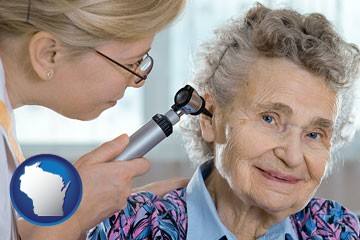 a otolaryngologist examining the ear of a patient - with Wisconsin icon